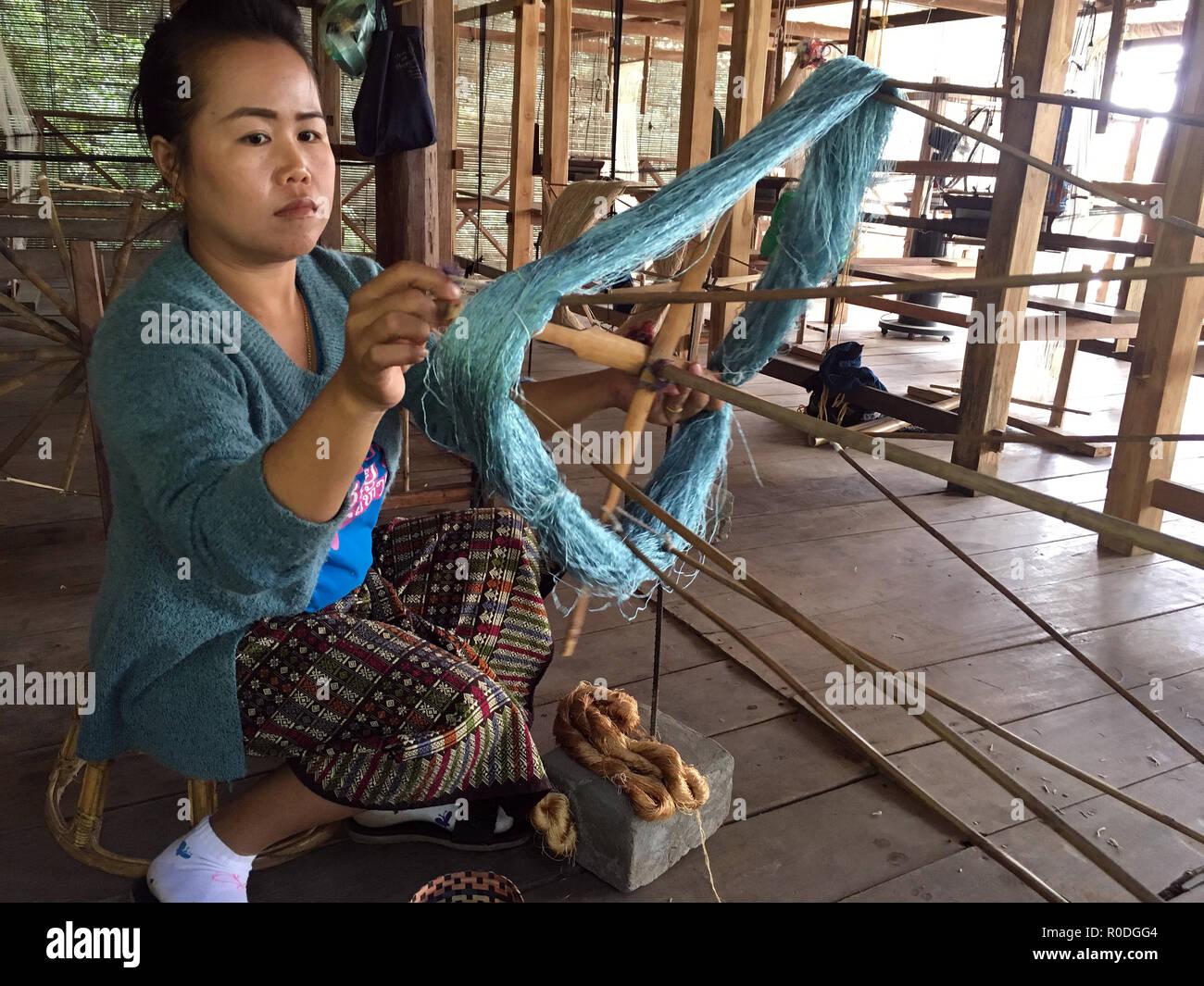 Winding a ream of silk into skeins at Ok Pop Tok weaving center, Luang Prabang, Laos - Stock Image