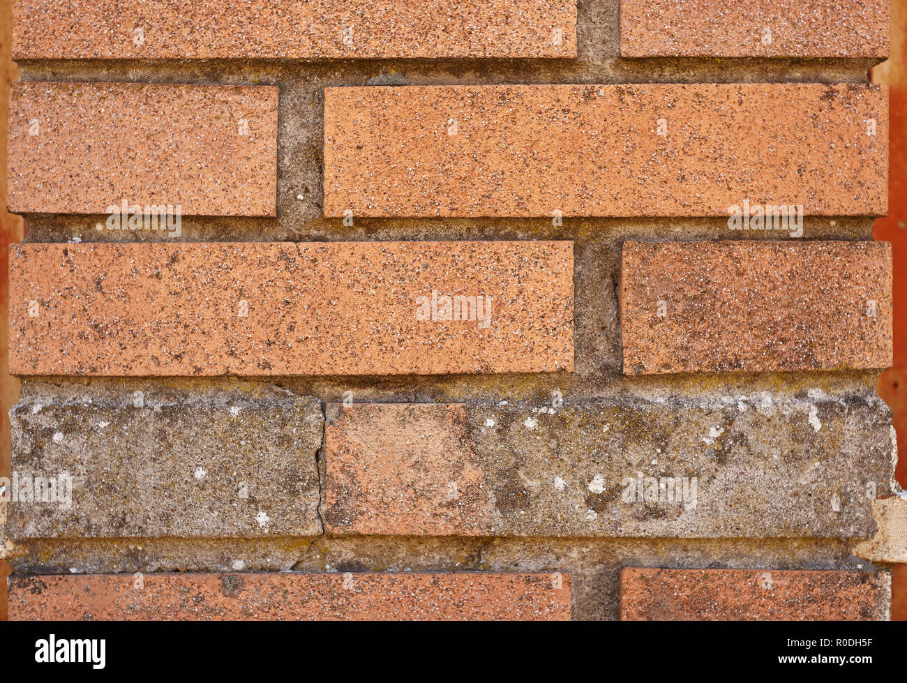 Texture of bricks in a wall usable as a background or graphic resource. - Stock Image