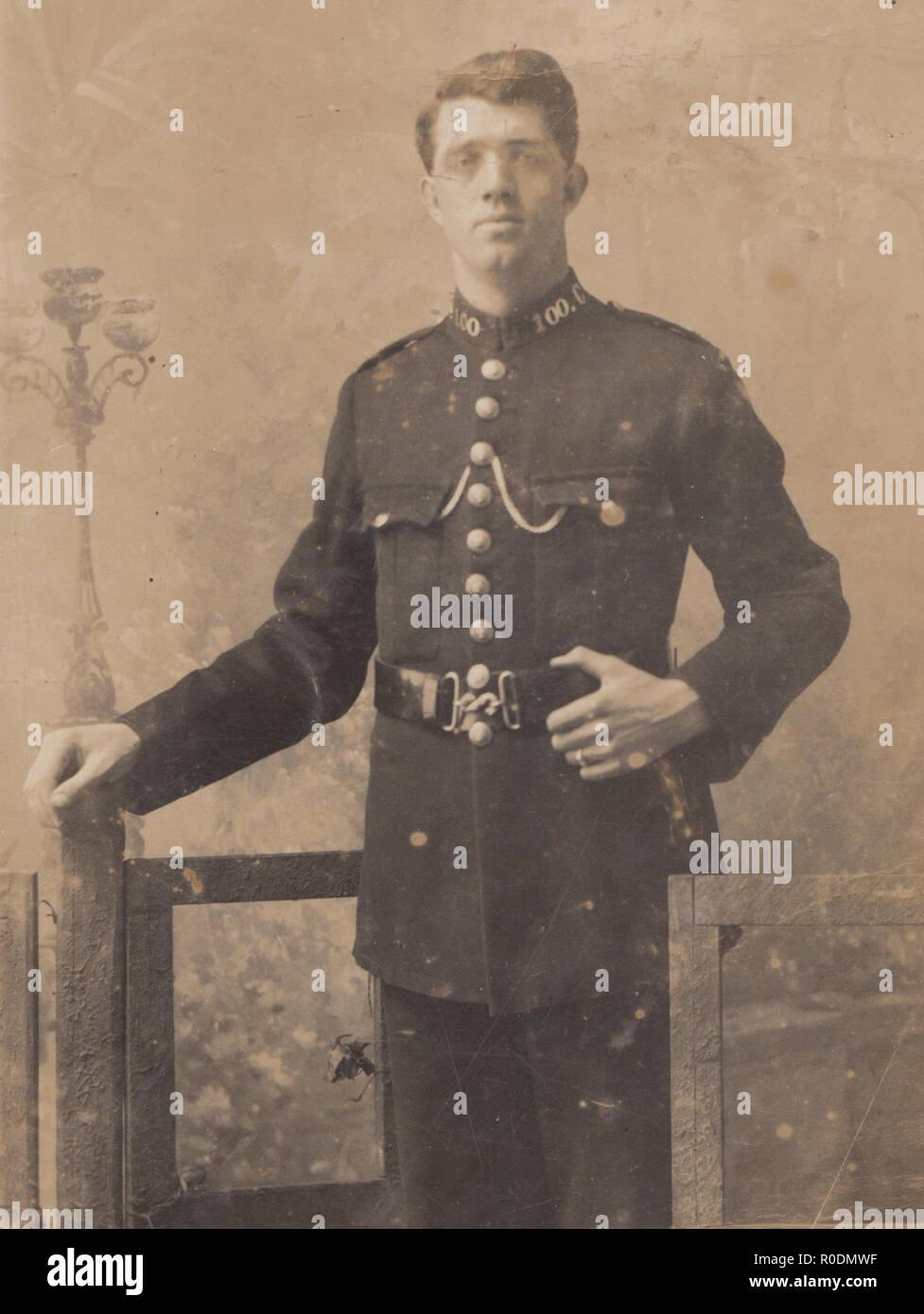 Vintage Photographic Postcard of a British Police Constable. Collar No 100.C - Stock Image