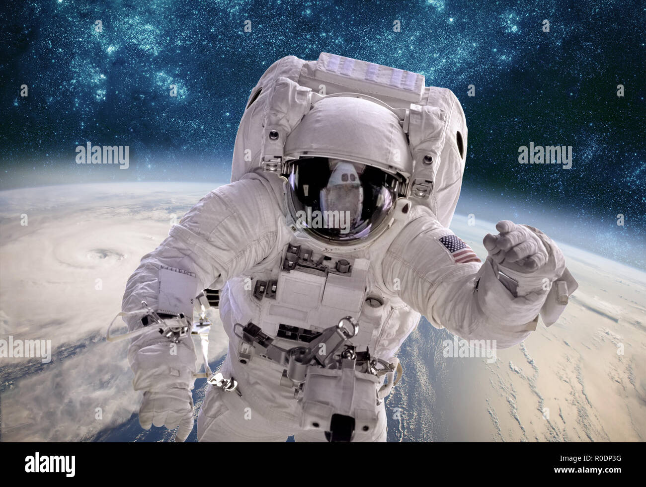Astronaut in outer space against the backdrop of the planet earth. Typhoon over planet Earth. Elements of this image furnished by NASA. - Stock Image