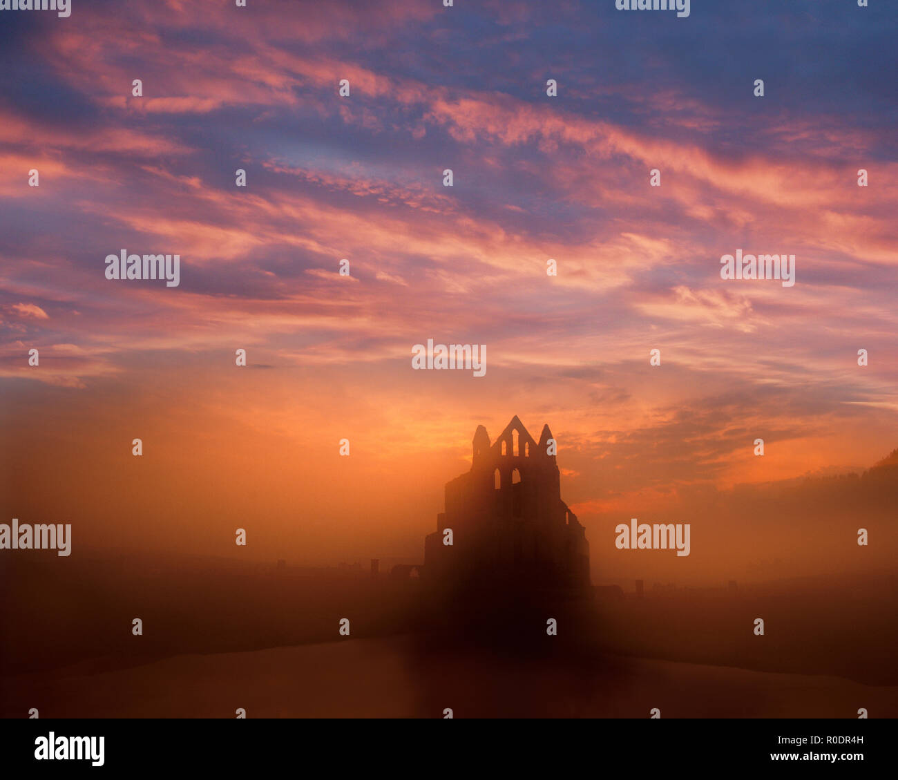 GB - NORTH YORKSHIRE: Sunet over Whitby Abbey Stock Photo