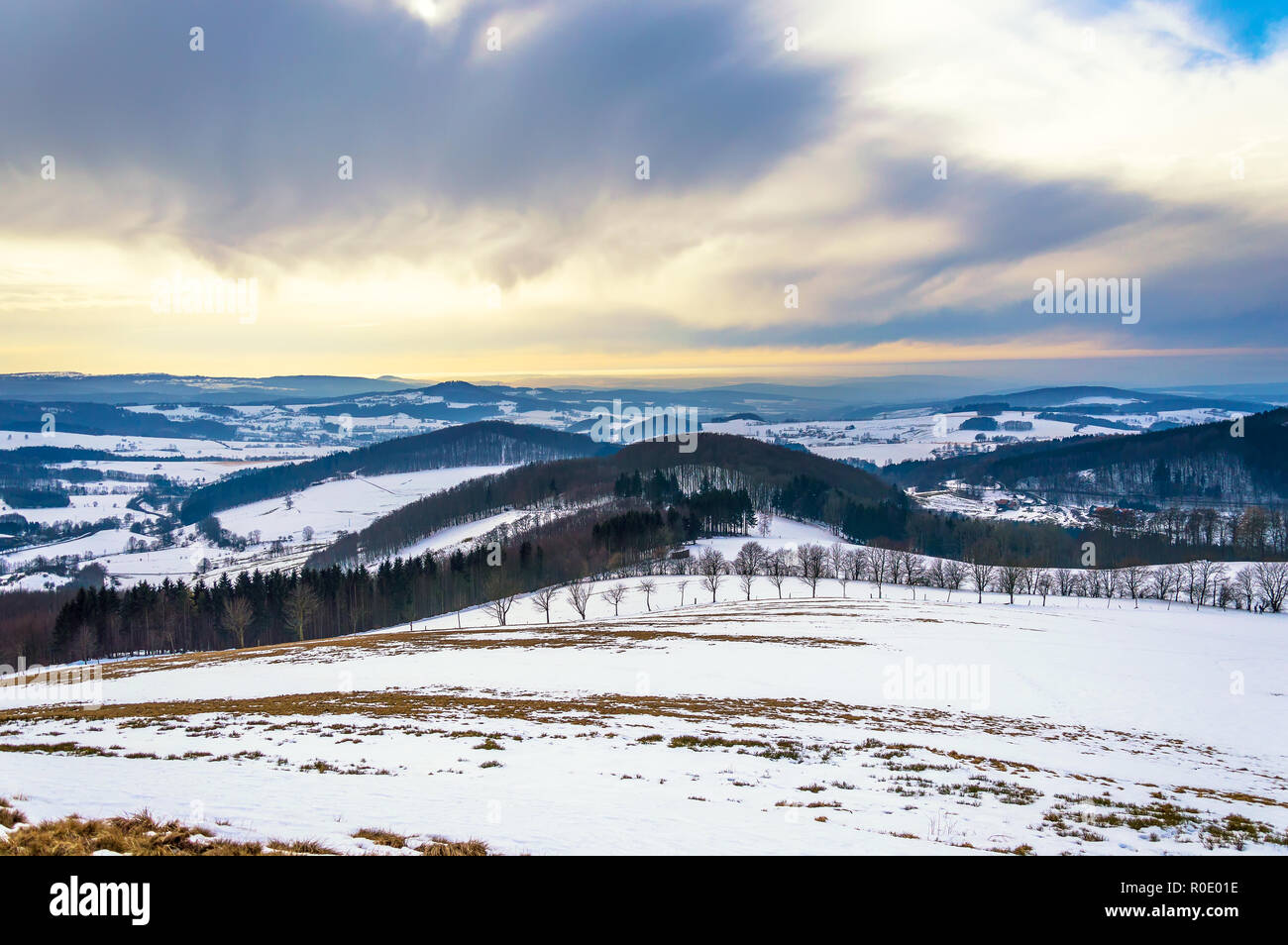 Majestic winter snowy landscape with dramatic sky in Rhön Mountains, Hesse, Germany - Stock Image