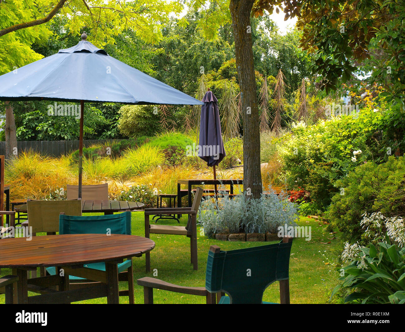 Dining Table In Sunny Garden Patio With Sunshade Stock Photo ...