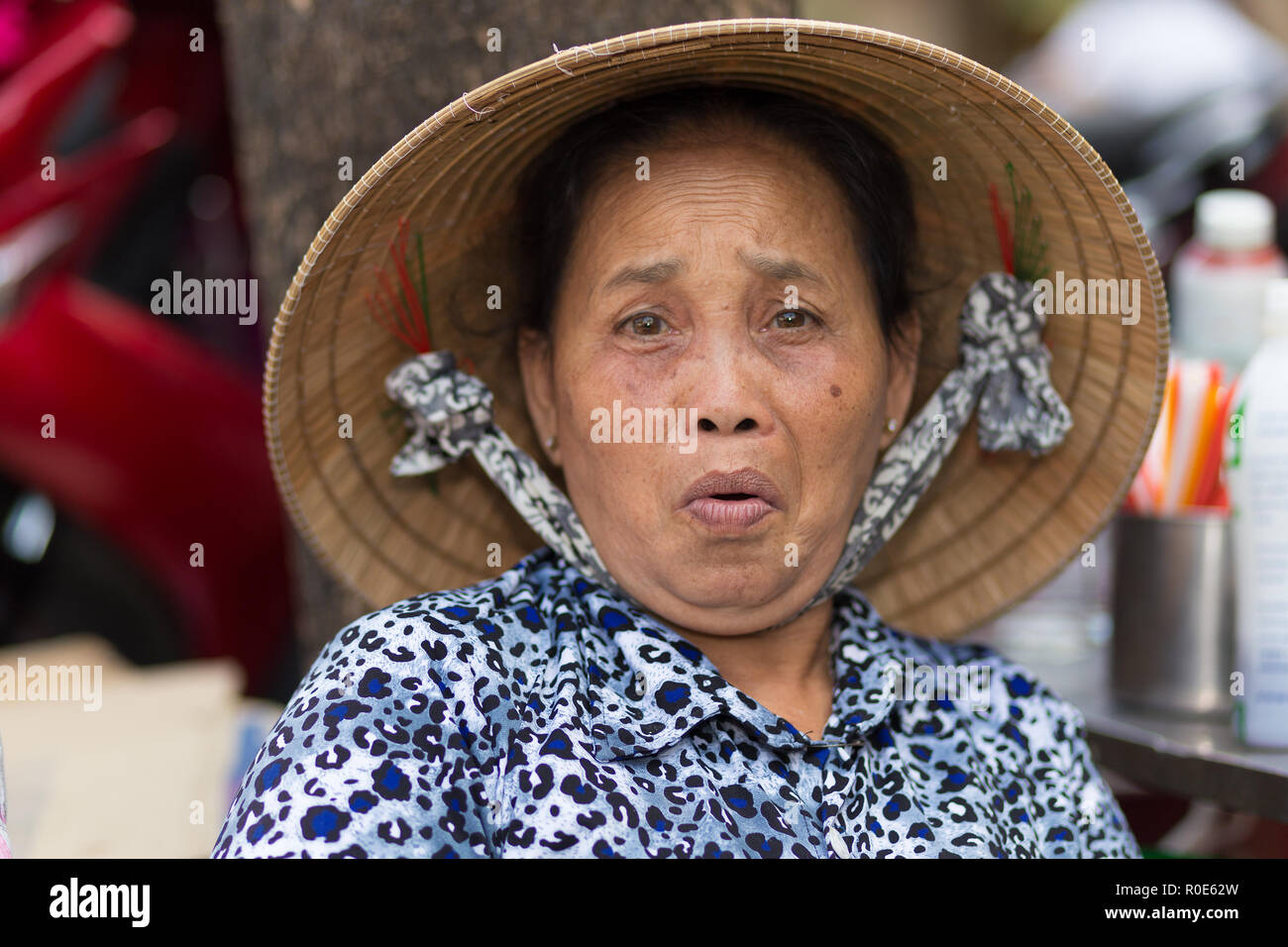SAIGON, VIETNAM, FEBRUARY 26, 2015 : A funny senior woman is making a grimace int he streets of Saigon (Ho Chi Minh), Vietnam - Stock Image