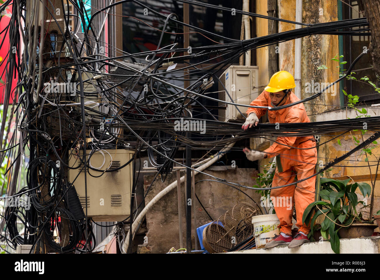 Hanoi Vietnam December 16 2014 A Technician Is Repairing Or Messy Network Wiring Checking The Electrical In City Of