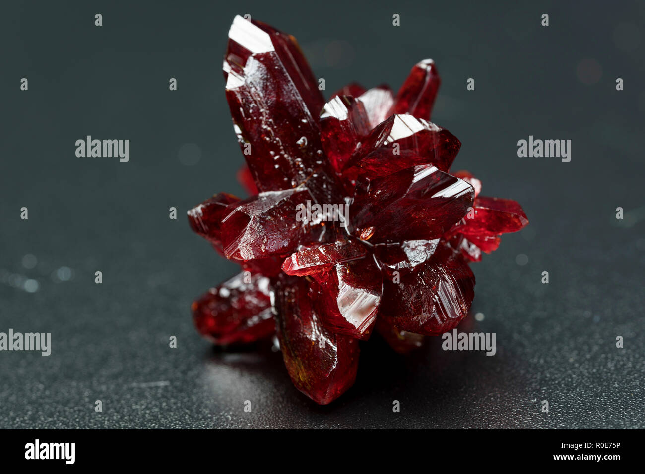 Red crystal mineral. - Stock Image