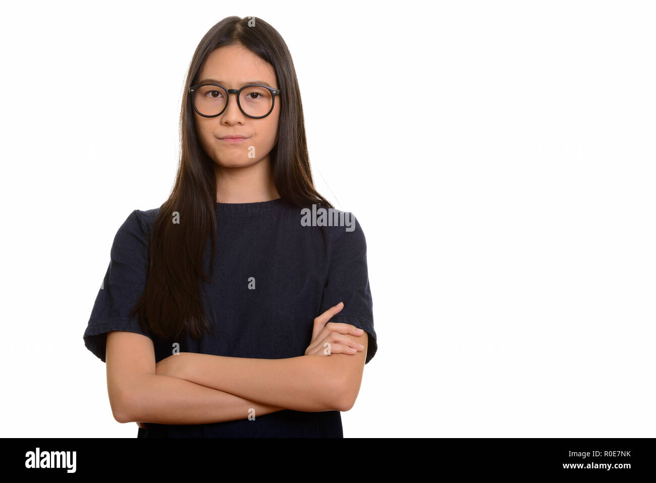 Young beautiful Asian teenage girl looking angry  - Stock Image