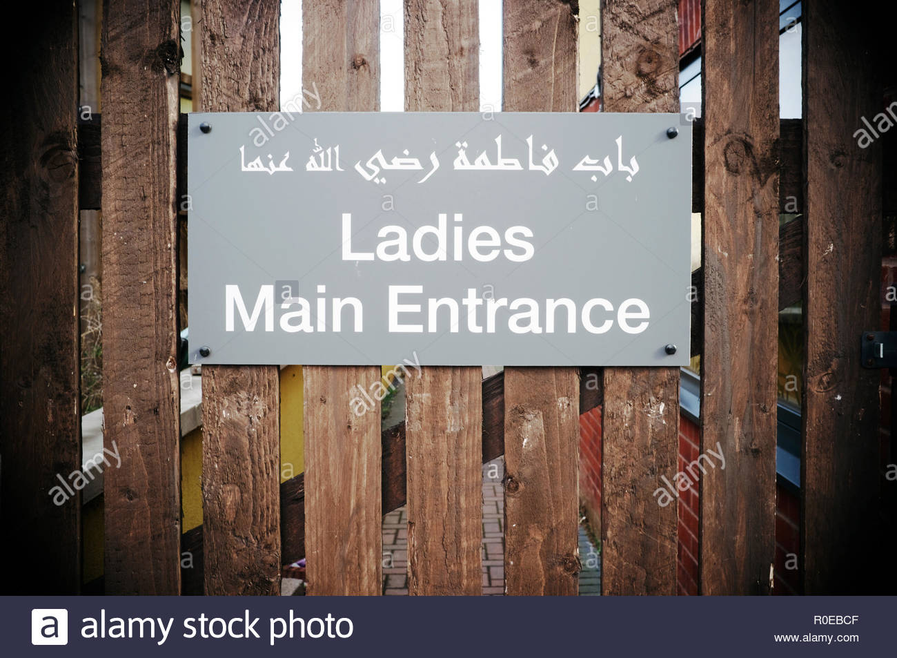 Segragated entrance for females to use, at the side of the Hazrat Bilal Centre in Sevier Street, Bristol, UK. - Stock Image