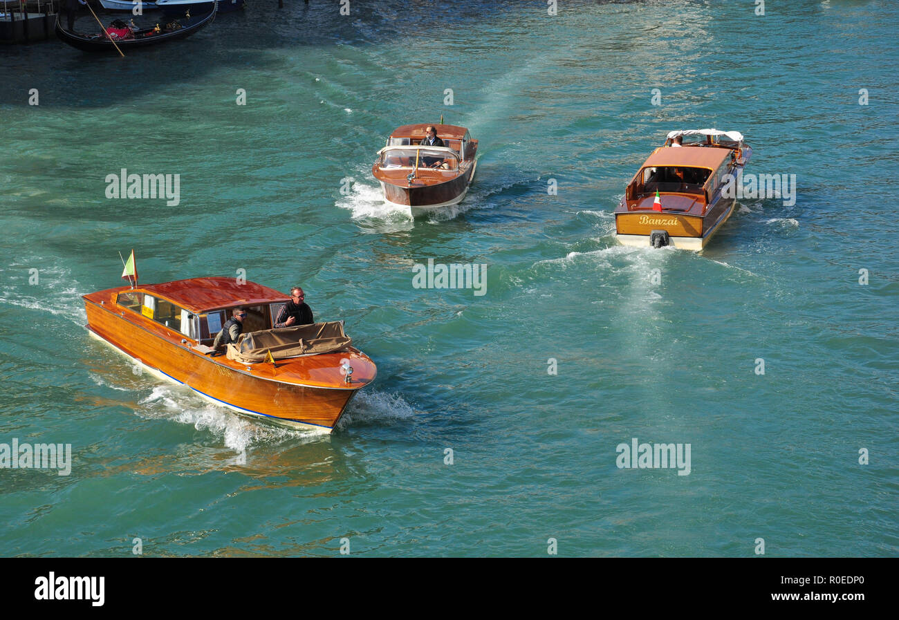 Grand Canal with three motor launches from Accademia Bridge, Venice, Italy - Stock Image