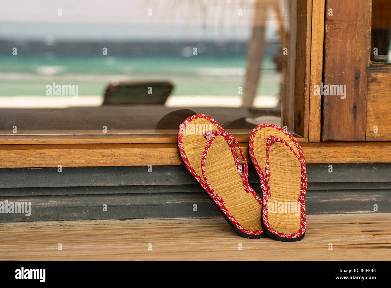 A pair of Flip Flops on a porch at the Maledives. - Stock Image