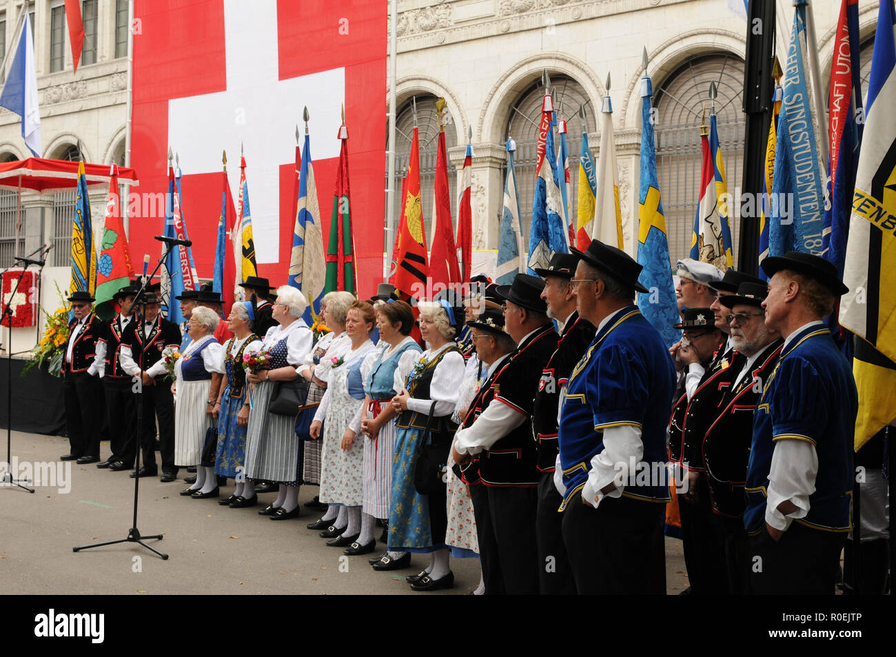 Male and female chorus of a swiss folklore group at the national day parade in Zürich-city - Stock Image