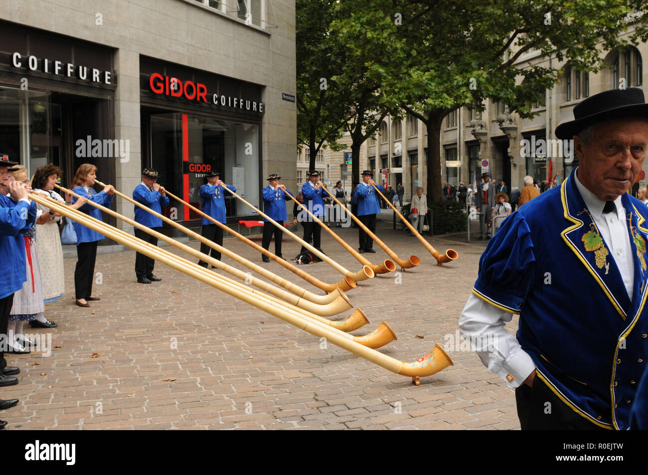 Alphorn musicians at the swiss national day playing in Zürich-City - Stock Image