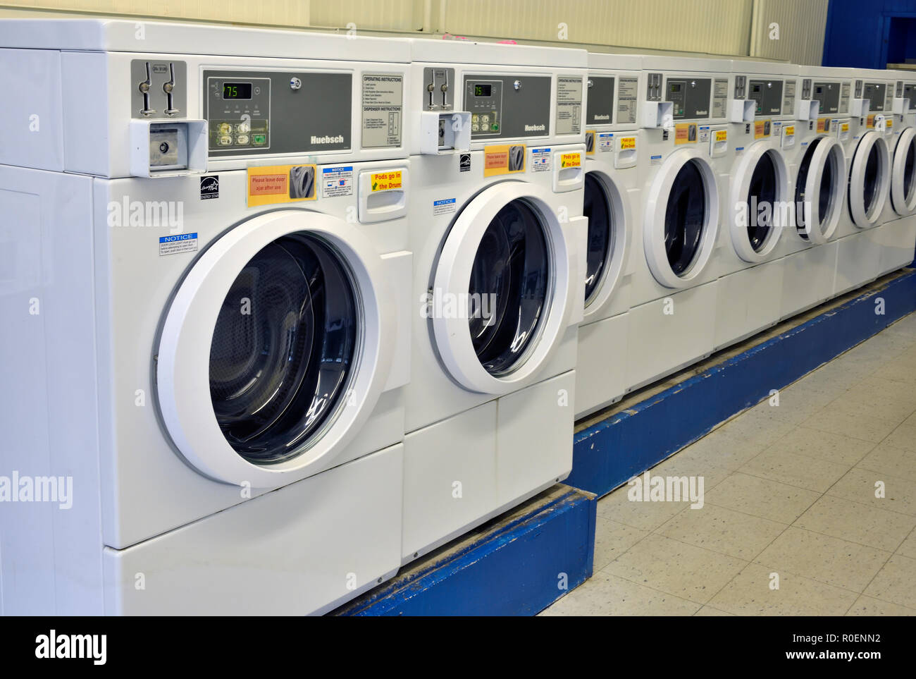 A line of coin operated washing machines in a laundry business in Sussex New Brunswick Canada - Stock Image