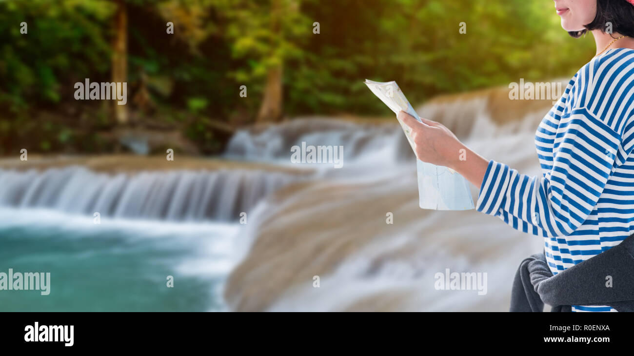 Teenager travel with country map, young tourist girl on vacation in Thailand - Stock Image