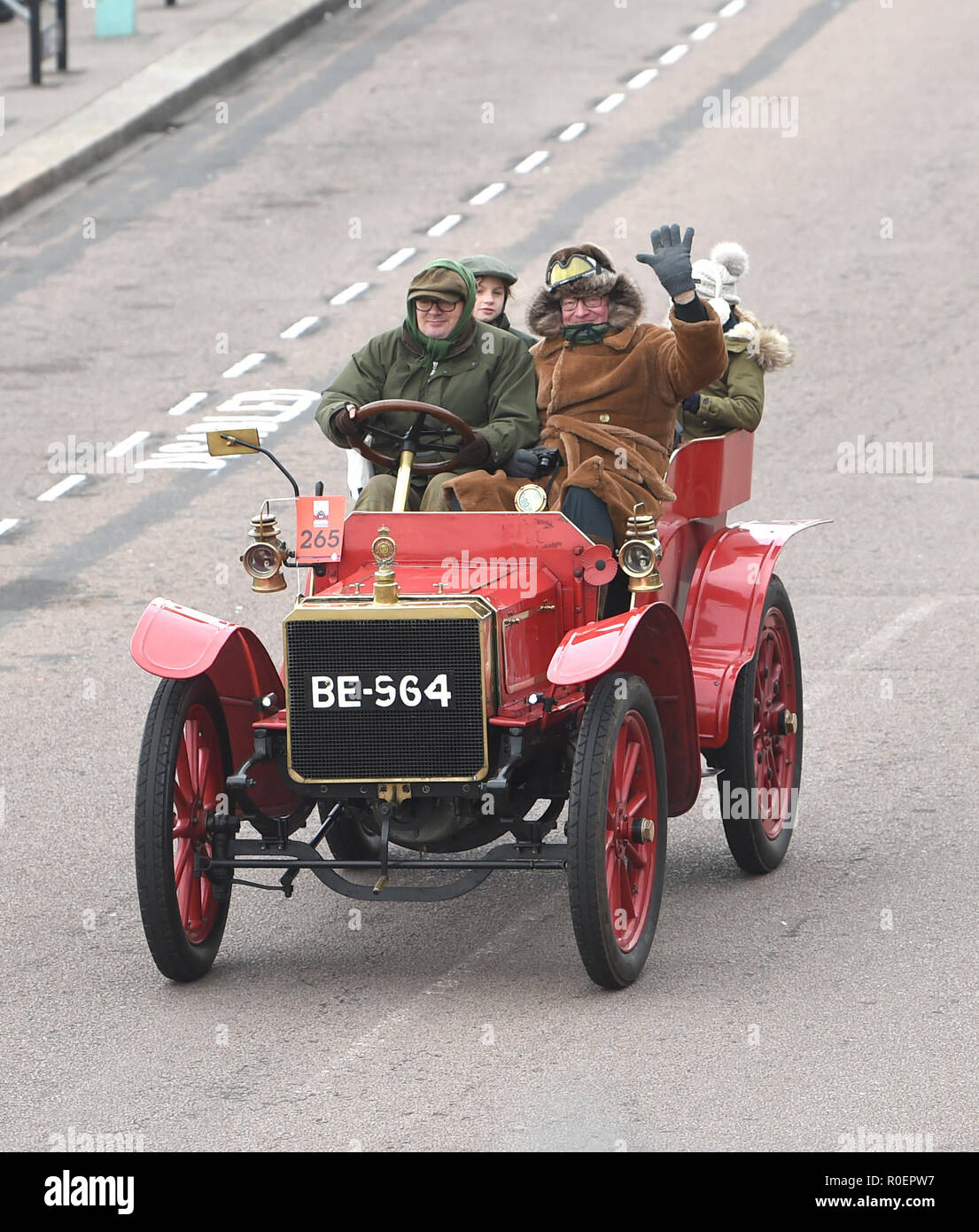Brighton UK 4th November 2018 - Viscount Randal Dunluce in a 1903 Martini at the finish line in the annual Bonhams London to Brighton Veteran Car Run supported by Hiscox . The run which starts in Hyde Park London and finishes in Madeira Drive on Brighton seafront is open to four-wheeled cars, tri-cars and motor tricycles manufactured before 1st January 1905 Credit: Simon Dack/Alamy Live News - Stock Image