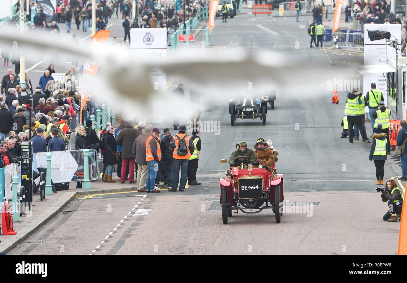 Brighton UK 4th November 2018 - A seagull swoops over Viscount Randal Dunluce in a 1903 Martini at the finish line  in the annual Bonhams London to Brighton Veteran Car Run supported by Hiscox . The run which starts in Hyde Park London and finishes in Madeira Drive on Brighton seafront is open to four-wheeled cars, tri-cars and motor tricycles manufactured before 1st January 1905 Credit: Simon Dack/Alamy Live News - Stock Image