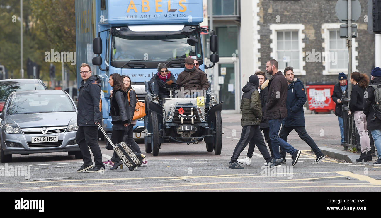 Brighton UK 4th November 2018 - Clive Boothamn allows pedestrians to cross in his 1902 Napier in the annual Bonhams London to Brighton Veteran Car Run supported by Hiscox . The run which starts in Hyde Park London and finishes in Madeira Drive on Brighton seafront is open to four-wheeled cars, tri-cars and motor tricycles manufactured before 1st January 1905 Credit: Simon Dack/Alamy Live News - Stock Image