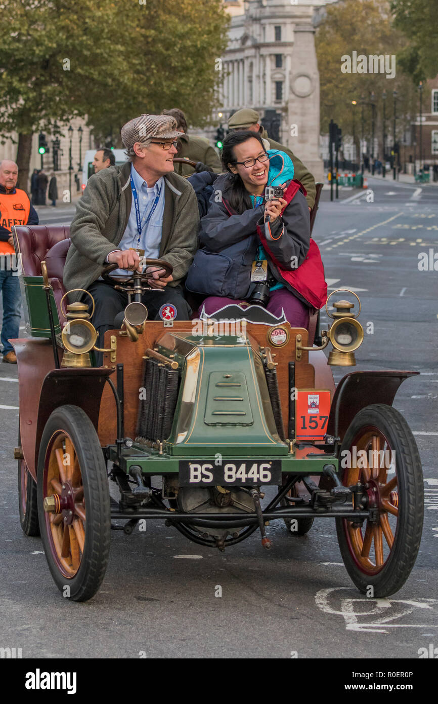 London, UK. 4th November, 2018. Driving down Whitehall - Bonhams London to Brighton Veteran Car Run celebrates the 122nd anniversary of the original Emancipation Run of 1896 which celebrated the passing into law the Locomotives on the Highway Act so raising the speed limit for 'light automobiles' from 4mph to 14mph and abolishing the need for a man to walk in front of all vehicles waving a red flag. The Movember Foundation as our Official Charity Partner. Credit: Guy Bell/Alamy Live News Stock Photo