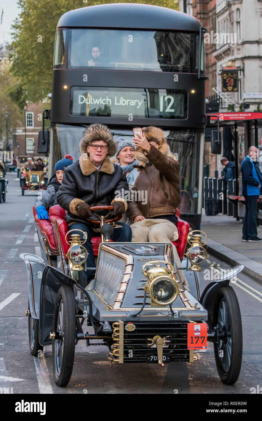 London, UK. 4th November, 2018. Driving down Whitehall - Bonhams London to Brighton Veteran Car Run celebrates the 122nd anniversary of the original Emancipation Run of 1896 which celebrated the passing into law the Locomotives on the Highway Act so raising the speed limit for 'light automobiles' from 4mph to 14mph and abolishing the need for a man to walk in front of all vehicles waving a red flag. The Movember Foundation as our Official Charity Partner. Credit: Guy Bell/Alamy Live News - Stock Image