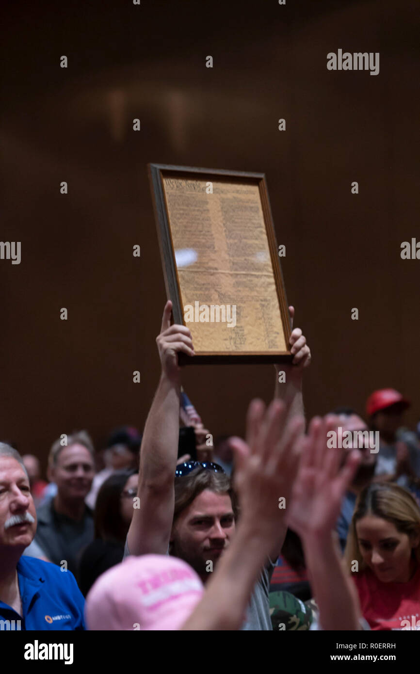 A man holds a copy of the Preamble to the U.S. Constitution at a rally in Corpus Christi, Texas, as Republican Sen. Ted Cruz campaigns for re-election in a close race against Democrat Beto O'Rourke. - Stock Image