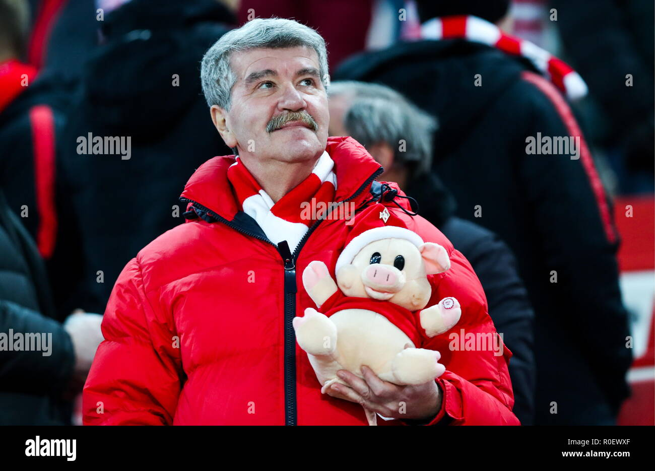 Moscow, Russia. 04th Nov, 2018. MOSCOW, RUSSIA - NOVEMBER 4, 2018: A supporter of Spartak Moscow with a soft toy during a 2018/2019 Russian Football Premiere League Round 13 football match between Spartak Moscow and Ural Yekaterinburg at Otrkytiye Arena. Sergei Savostyanov/TASS Credit: ITAR-TASS News Agency/Alamy Live News - Stock Image