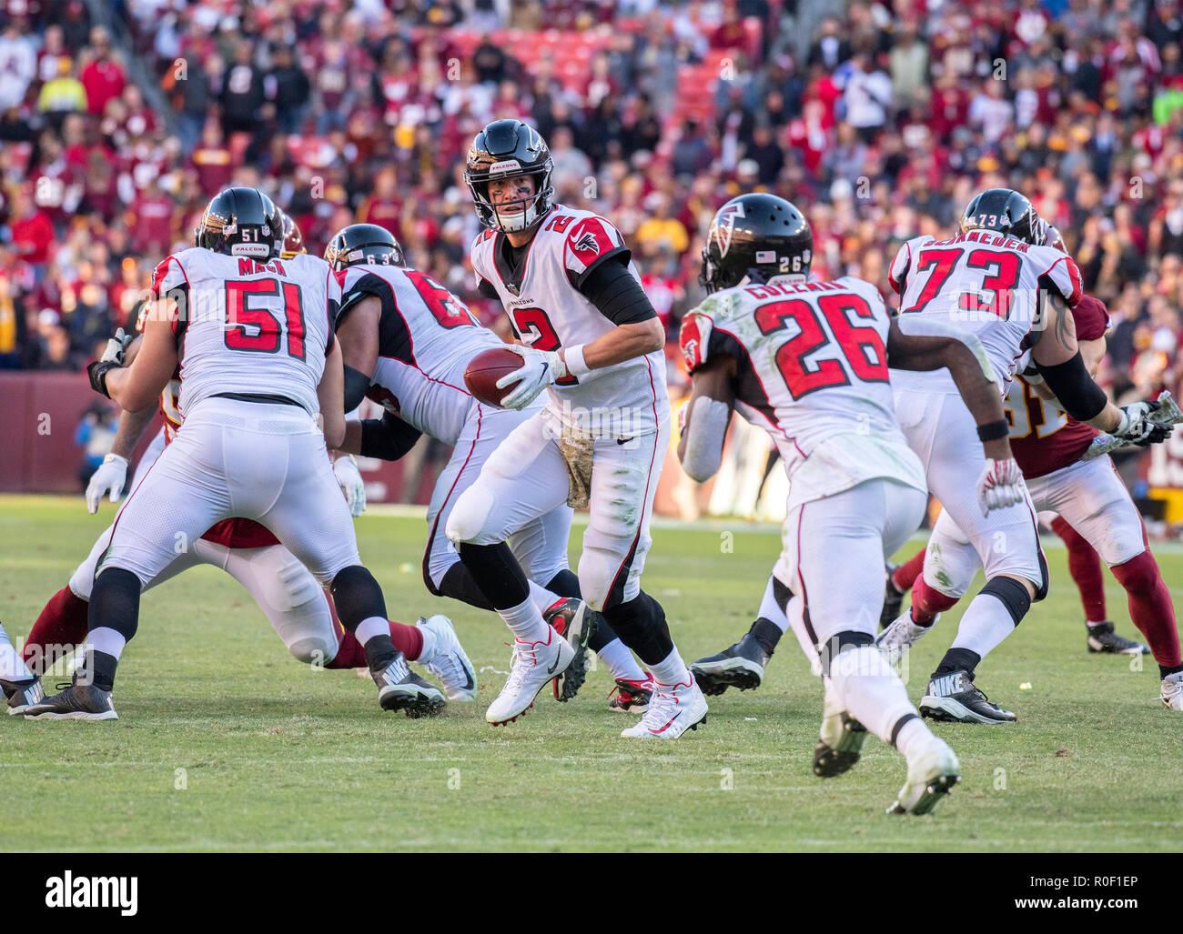 6ea80cfbc6e Atlanta Falcons quarterback Matt Ryan (2) hands-off to running back Tevin  Coleman