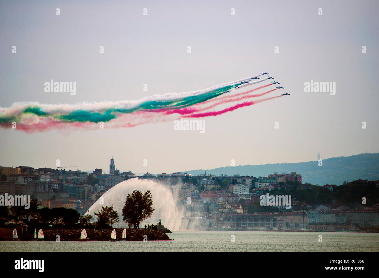 4 11 2018 Trieste, Italy. Acrobatic air performance of Frecce tricolori -- tricolour arrows. - Stock Image