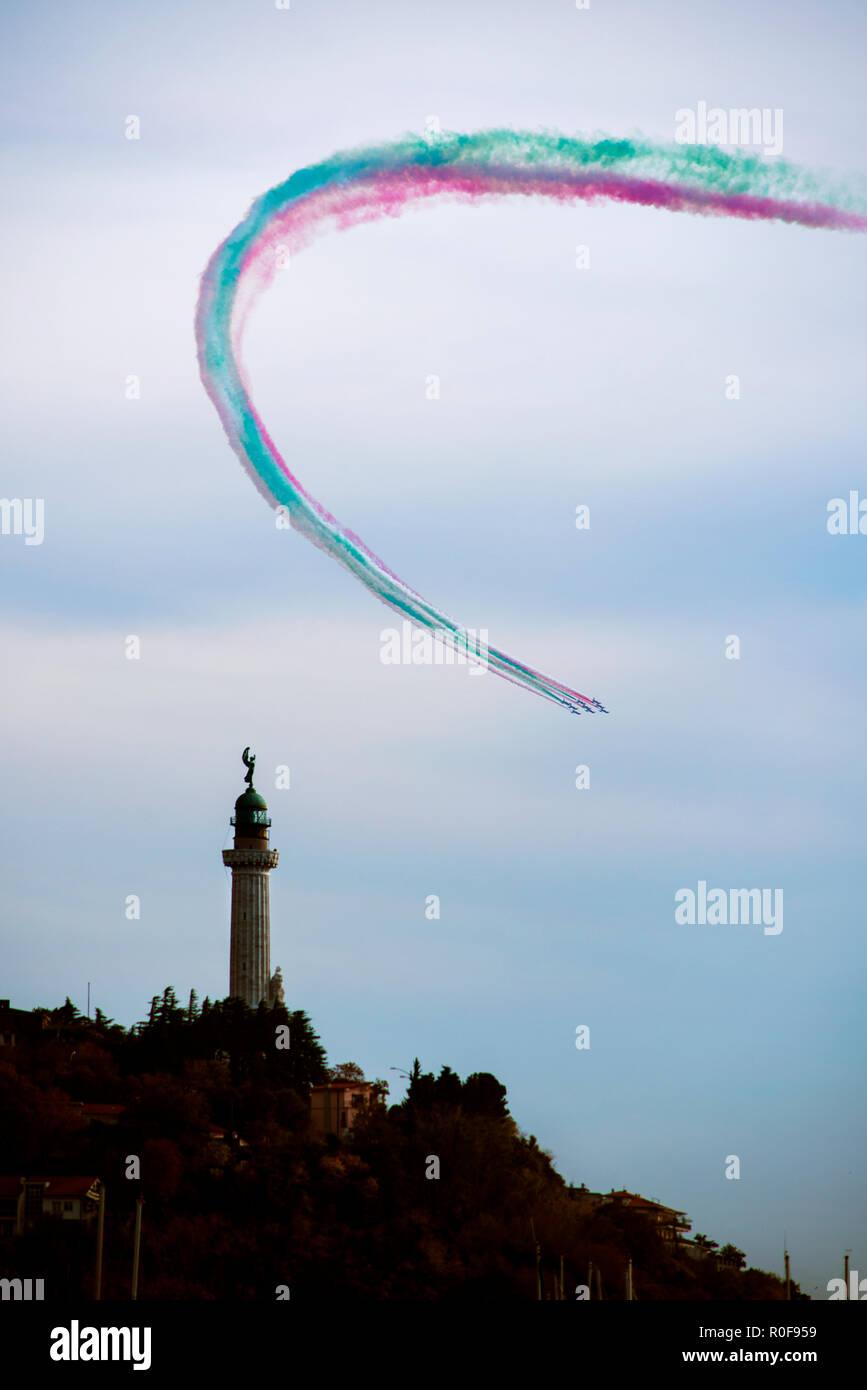 4 11 2018 Trieste, Italy. Acrobatic air performance of Frecce tricolori -- tricolour arrows. Stock Photo