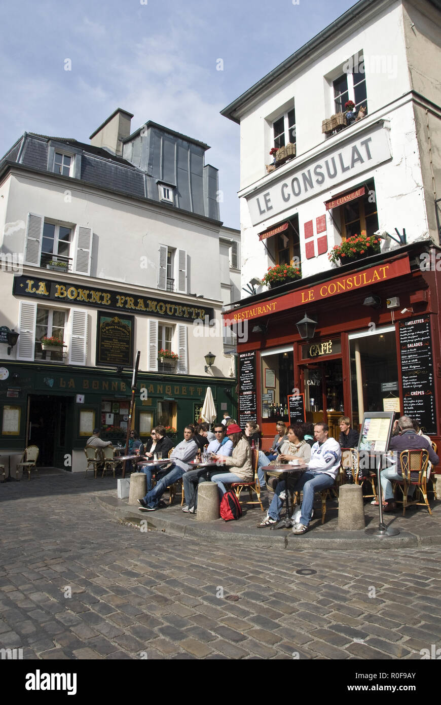 29cb47b0d8 People drink outside a cafe near the Place du Tertre on a sunny day in the