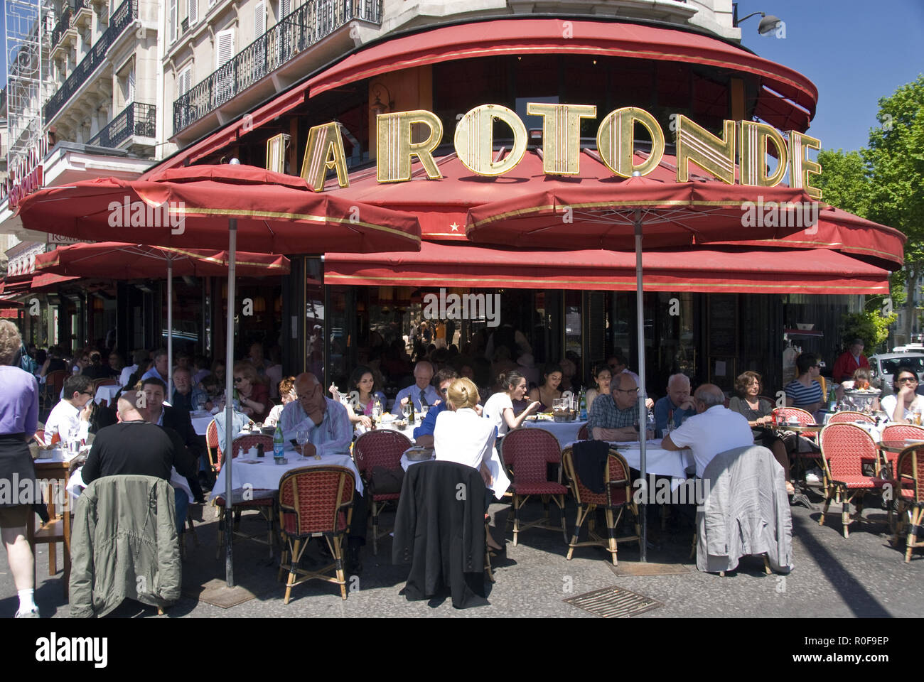 People lunch at La Rotonde, a popular and historic cafe in the Montparnasse area of Paris, France. - Stock Image