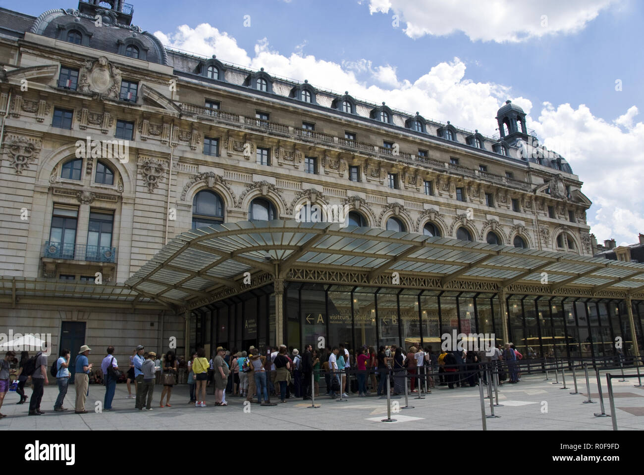 Tourists wait to enter the Musee d'Orsay, an art museum housed in the former Gare d'Orsay, a Beaux-Arts railway station, Paris, France. Stock Photo