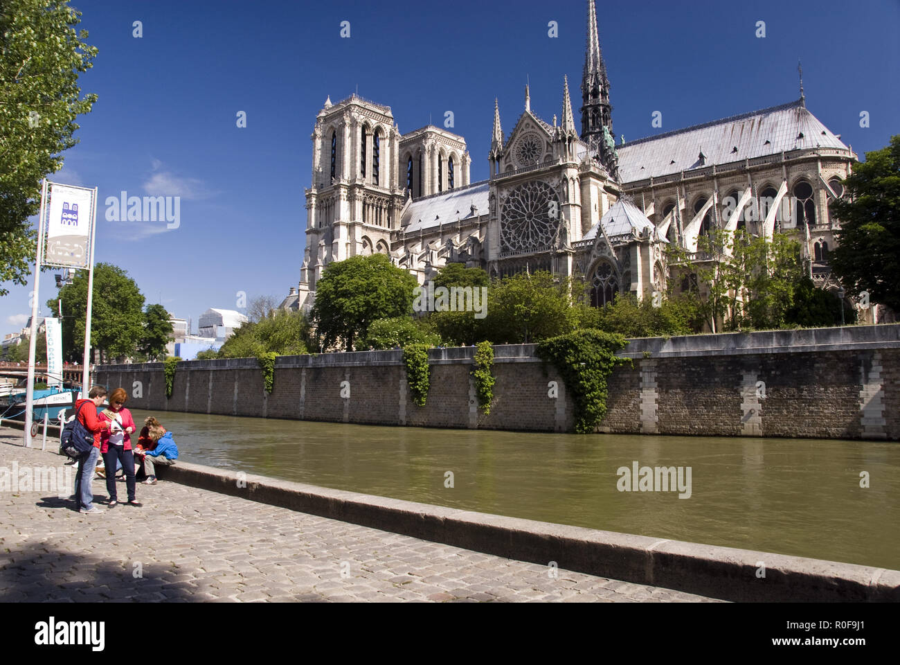 View of Notre Dame cathedral from a BatoBus (water bus) stop on the Seine river in Paris, France. Stock Photo