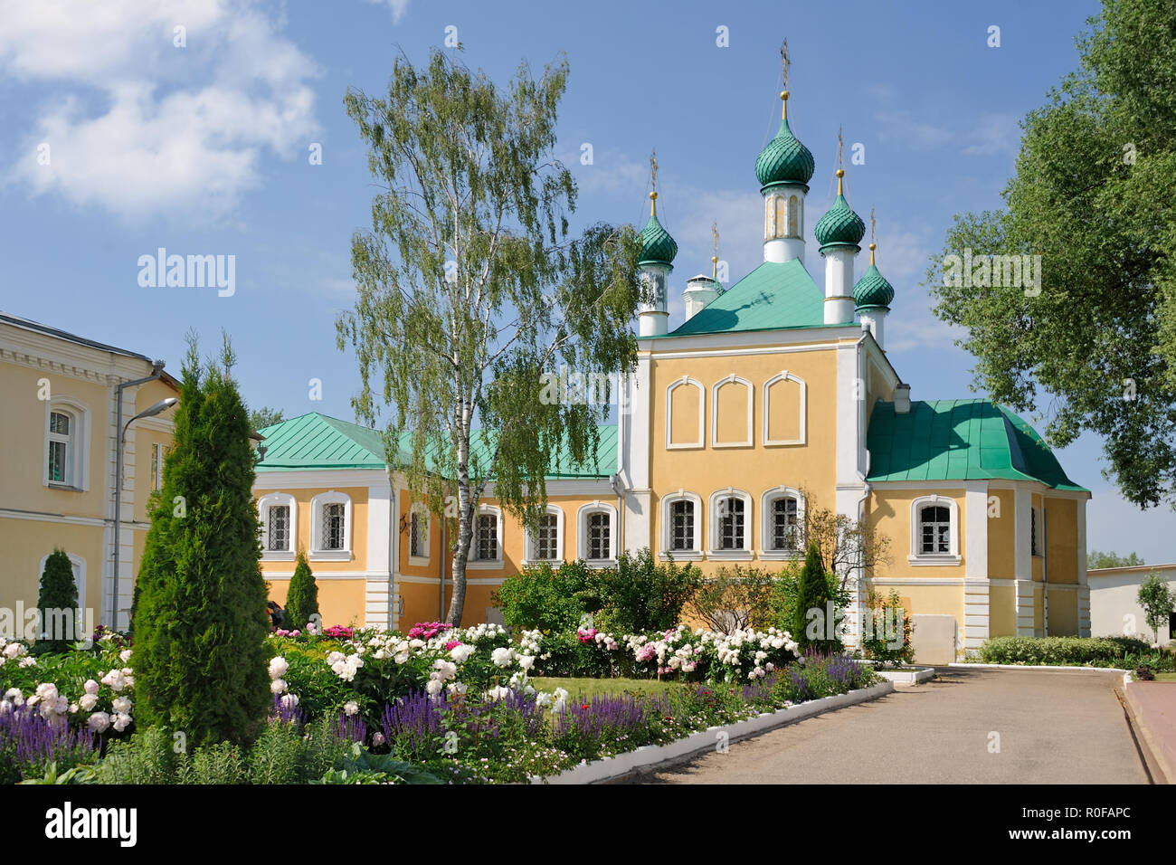 Monastic Garden and Annunciation Church Framed By Trees - Stock Image