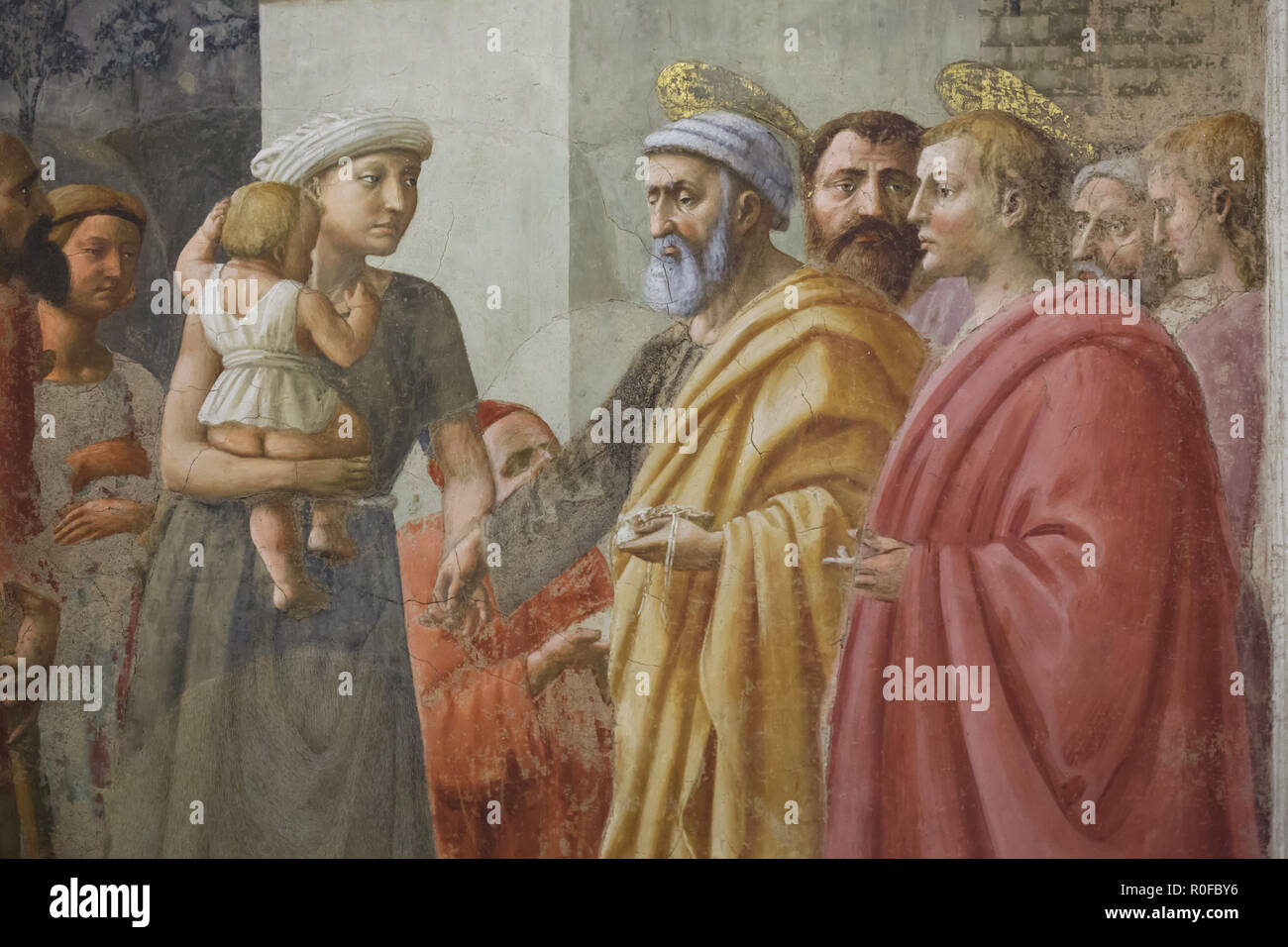 Detail of the fresco 'Distribution of Alms and Death of Ananias' by Italian Renaissance painter Masaccio (1426-1427) in the Brancacci Chapel (Cappella Brancacci) in the Church of Santa Maria del Carmine in Florence, Tuscany, Italy. Stock Photo