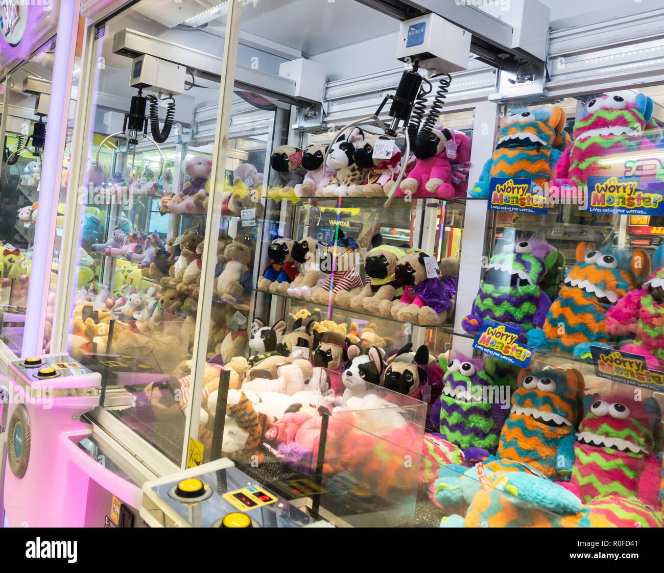 Cran grab machine in seaside arcade. - Stock Image