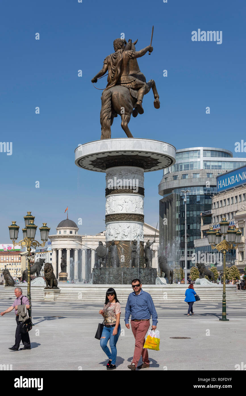 'Warrior on a Horse' statue and fountains at dusk, Macedonia Square, Skopje, Skopje Region, Republic of Macedonia - Stock Image