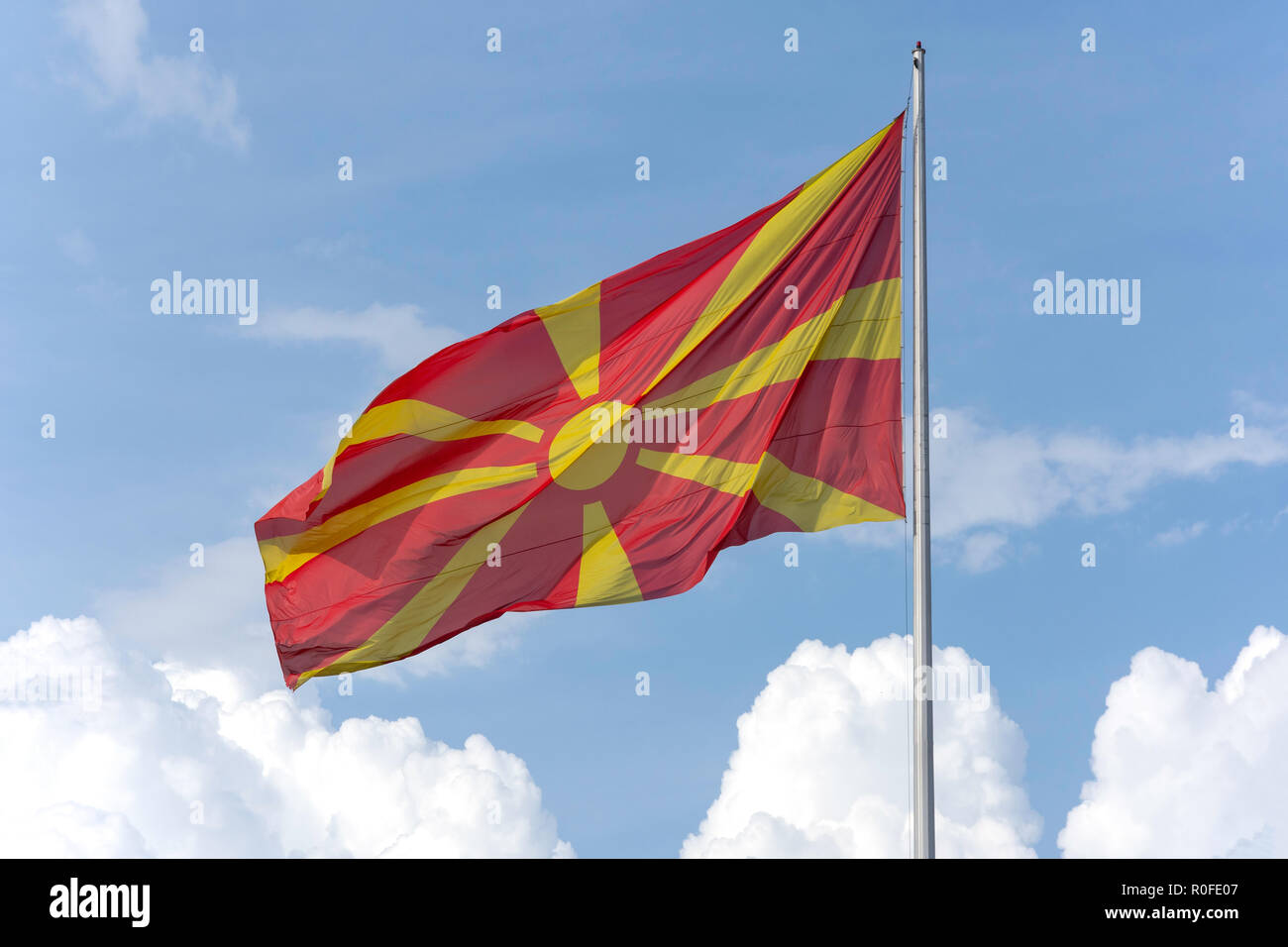 Macedonian flag on flagpole, Skopje, Skopje Region, Republic of Macedonia - Stock Image