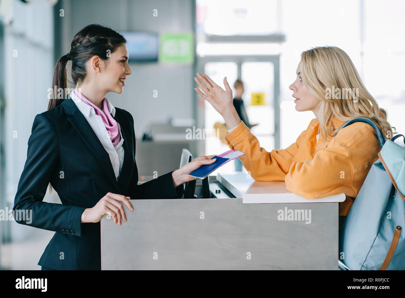 Fantastic Smiling Airport Worker Checking Documents Of Young Female Download Free Architecture Designs Xerocsunscenecom