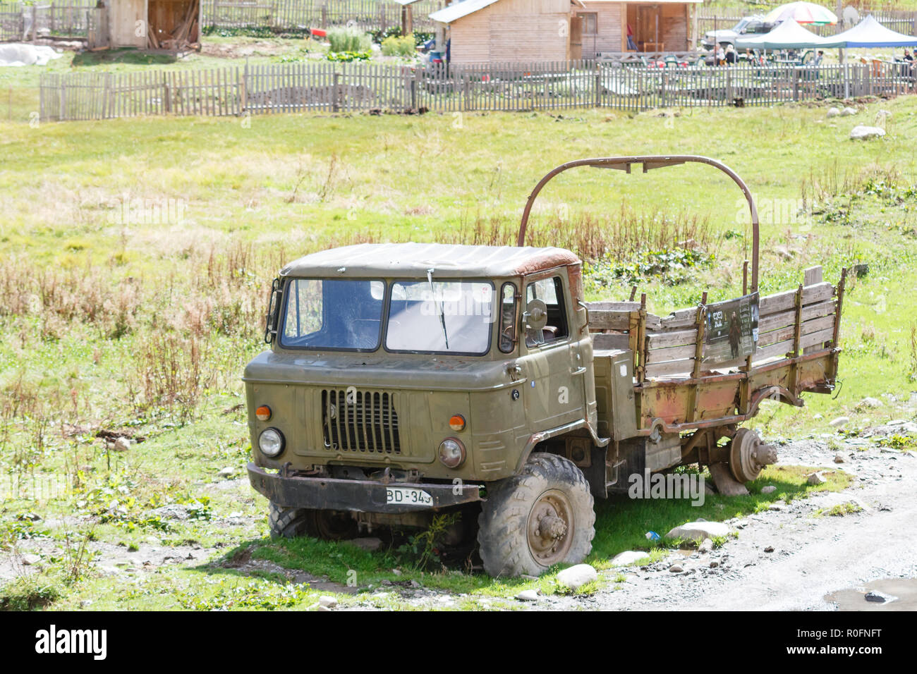 Old abandoned rusty military truck. Sunny day in Ushguli, Svaneti, Georgia - Stock Image
