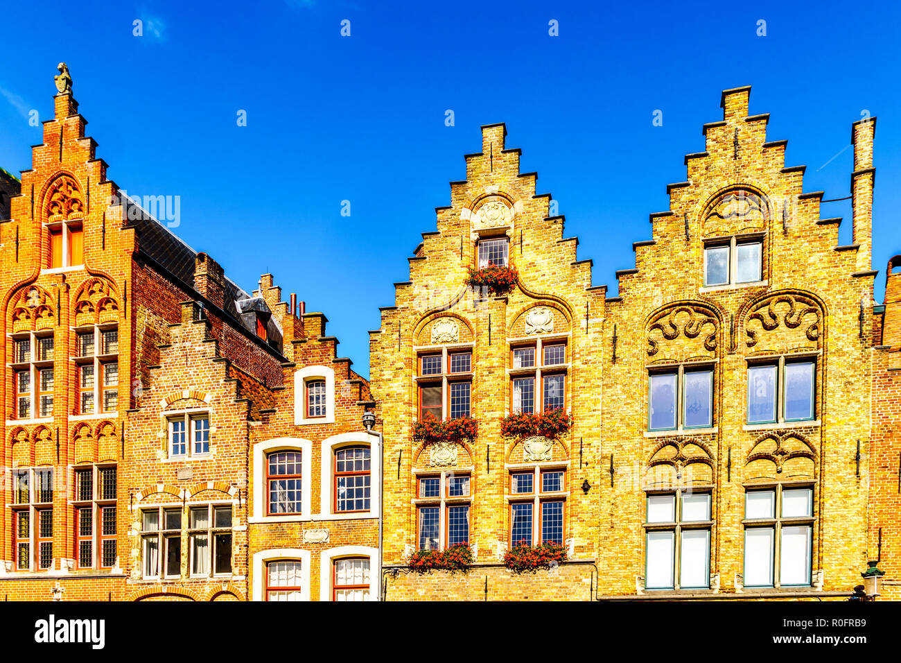 Medieval houses with step gables in the historic and famous city of Bruges, Belgium - Stock Image