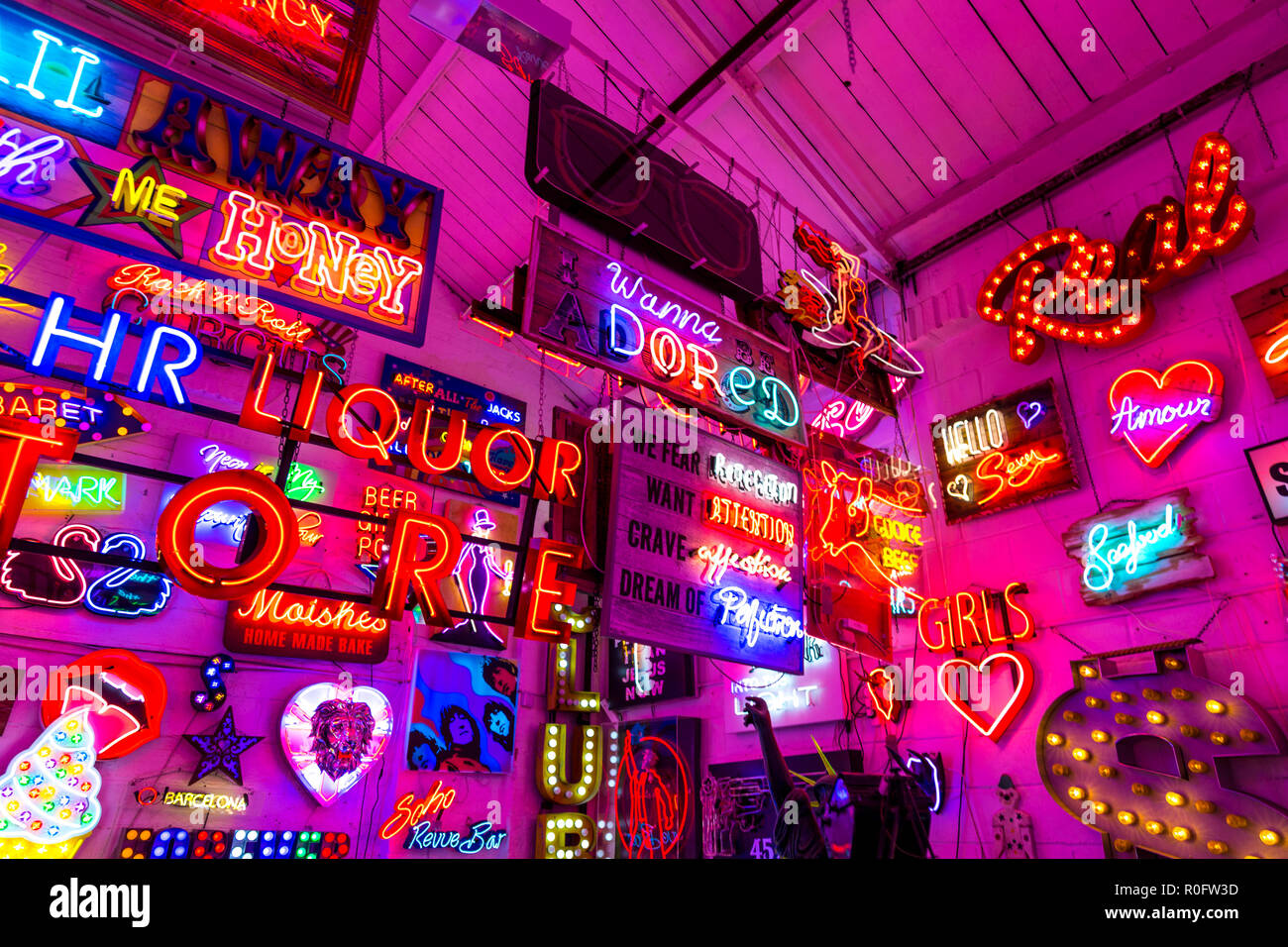 Room full of bright colourful neon signs, neon shop Gods Own Junkyard, Walthamstow, London, UK - Stock Image
