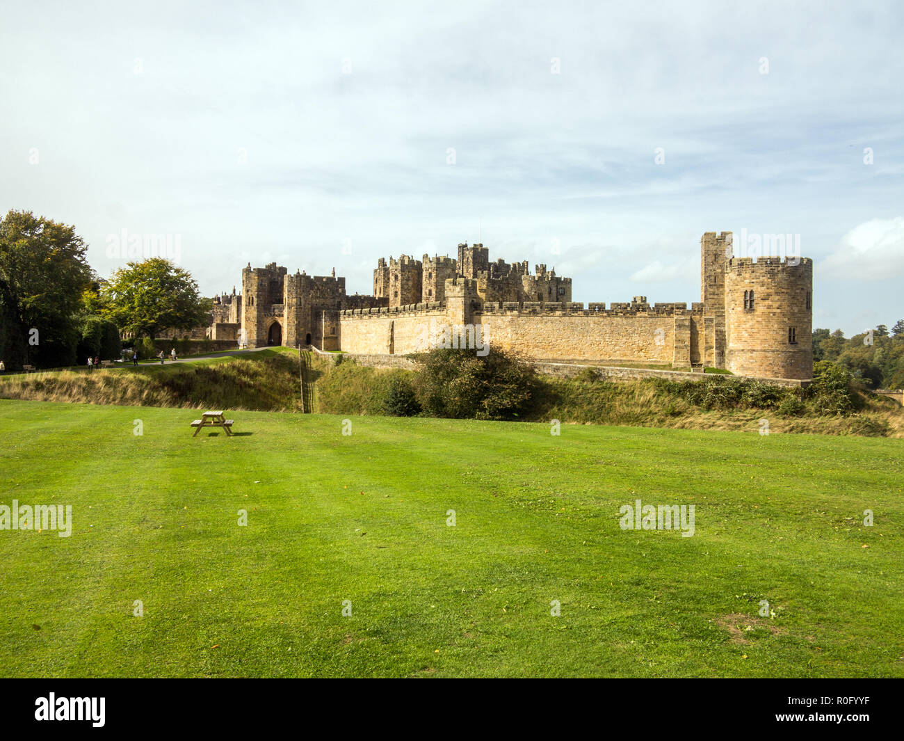 Alnwick castle and grounds seat of the Percy family and ancestral home to the Duke of Northumberland in the Northumberland countryside England UK - Stock Image