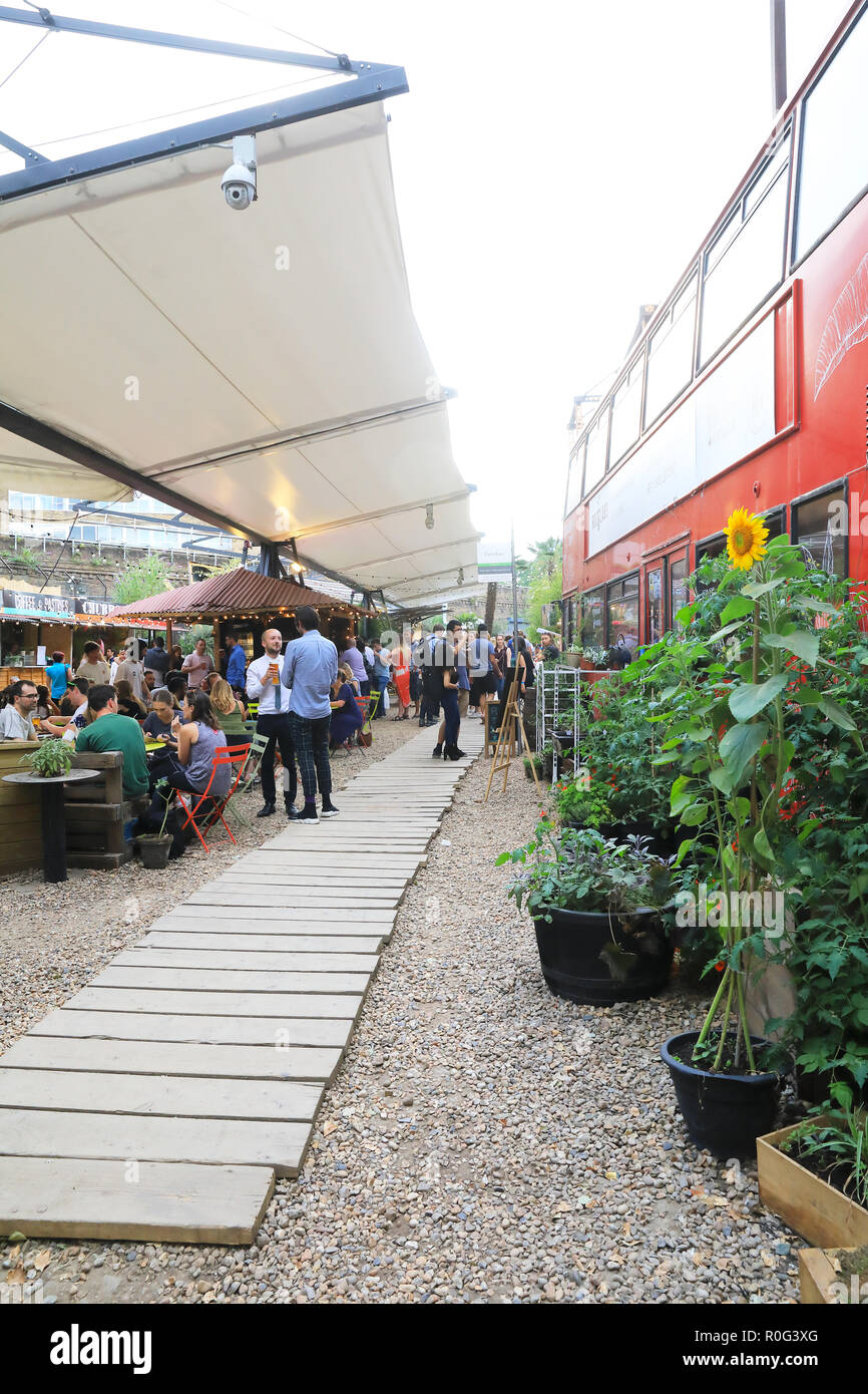 Trendy Mercato Metropolitano, in a disused paper factory, and part of the Elephant & Castle's regeneration project, in SE London, UK - Stock Image