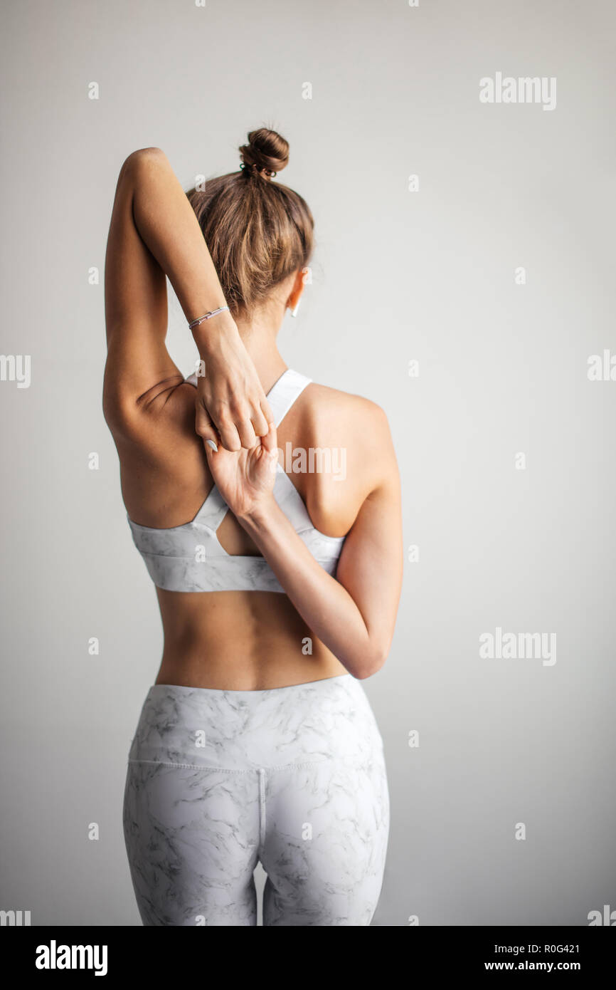 Woman in yoga class making Reverse Prayer Pose, Healthy lifestyle. - Stock Image