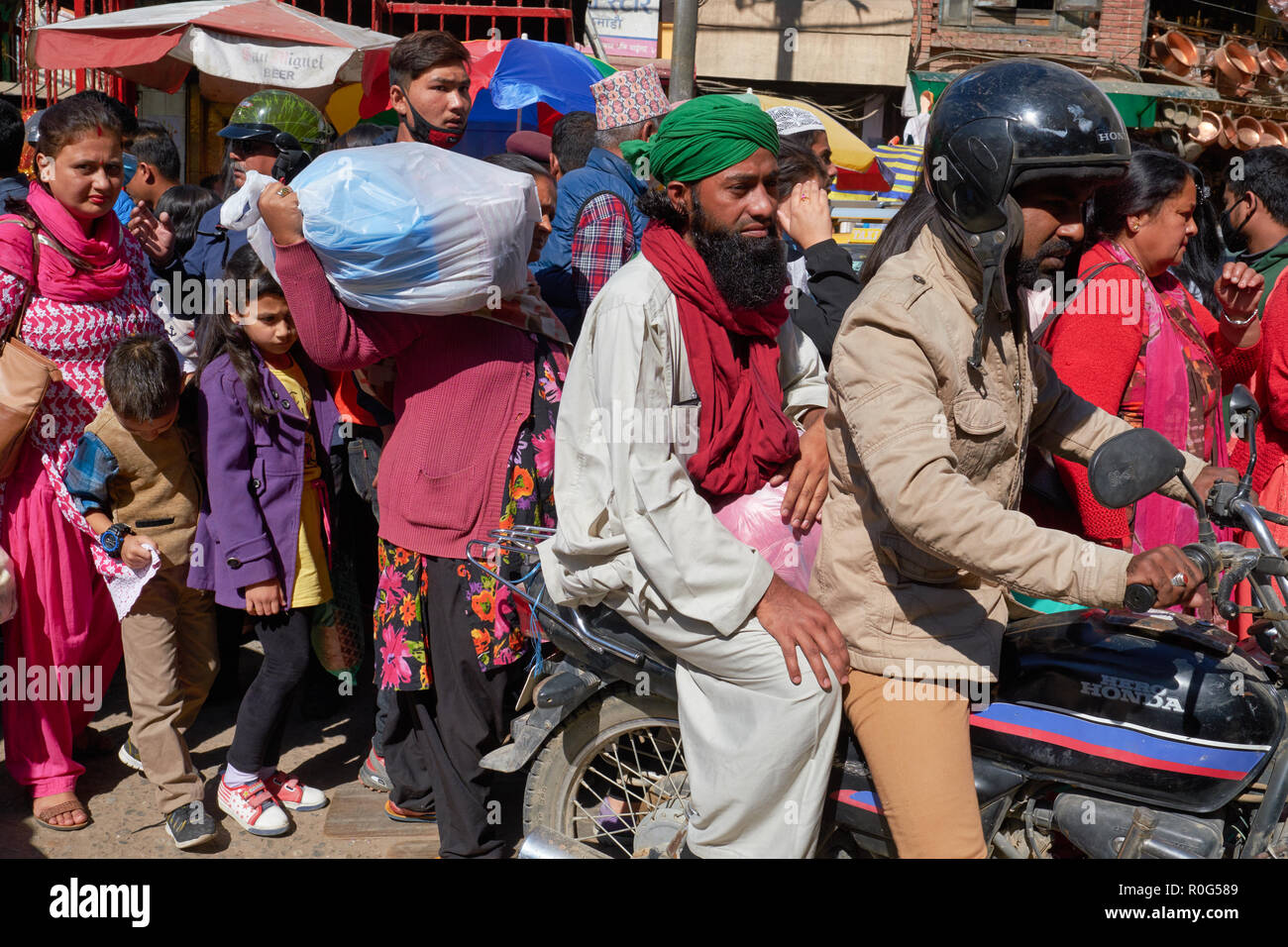 A lane in a market area in Kathmandu, Nepal, is jam-packed with motorcycles and pedestrians, a typical traffic situation for the Nepalese capital - Stock Image