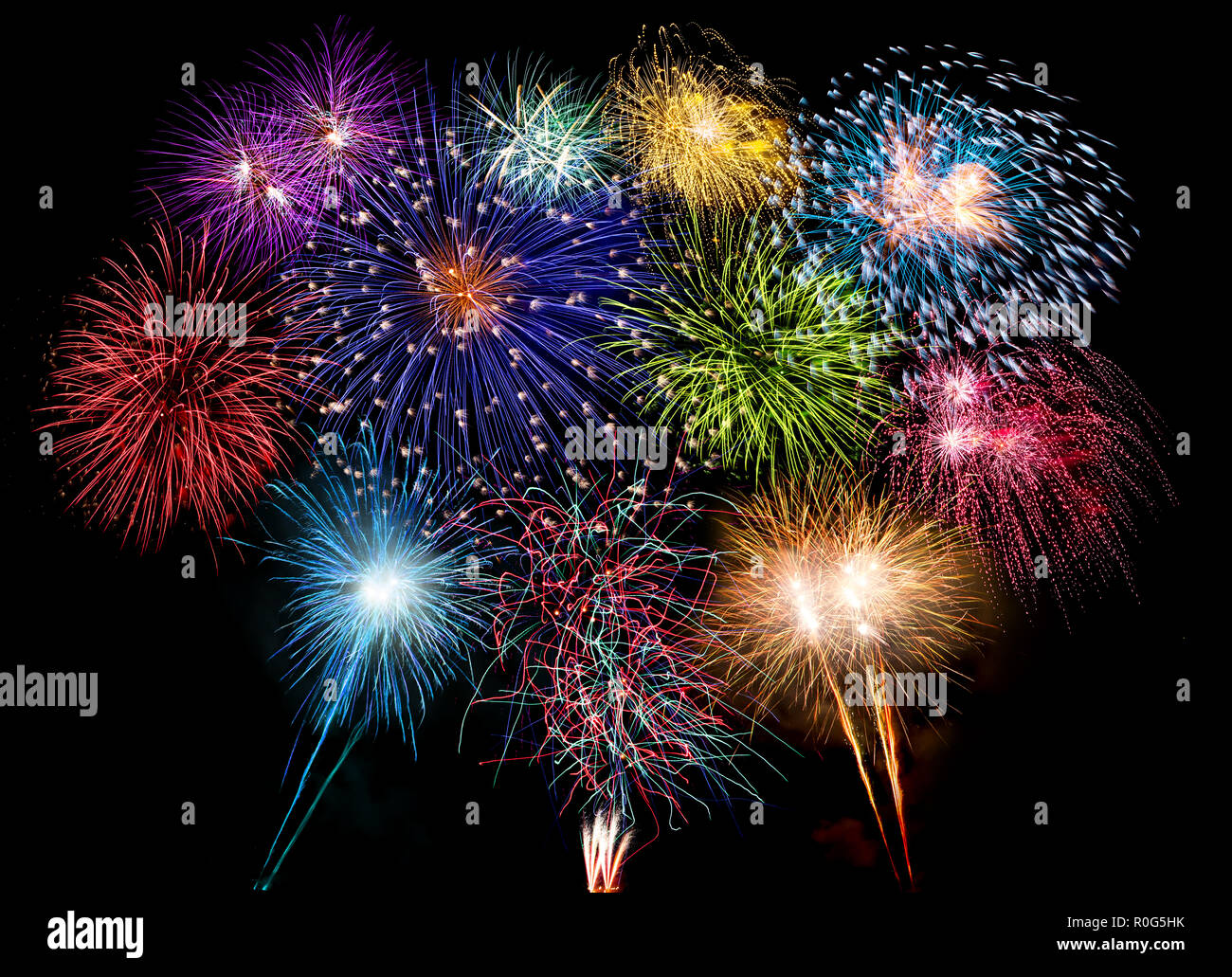 colorful fireworks display and bright sparkler pyrotechnic number 2019 happy new year sylvester concept on black blue background Stock Photo