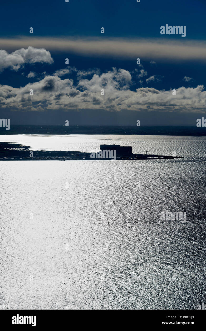 Heysham Power Station silhouetted, at Morecambe Bay, North West England, UK Stock Photo