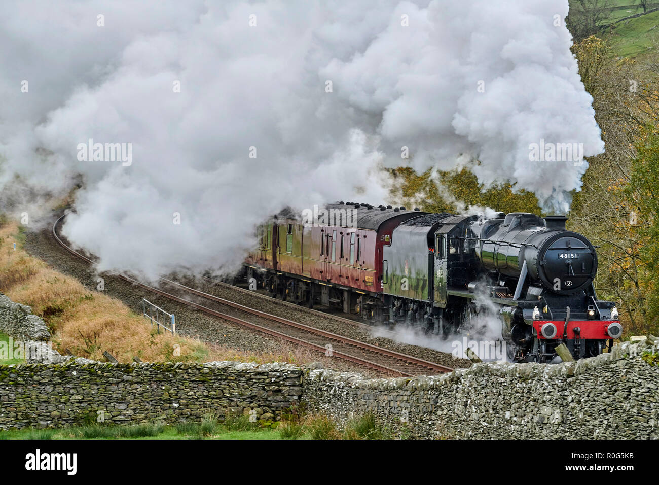 Preserved steam hauled train on the Settle & Carlisle Railway line, Yorkshire Dales National Park, Northern England, UK - Stock Image