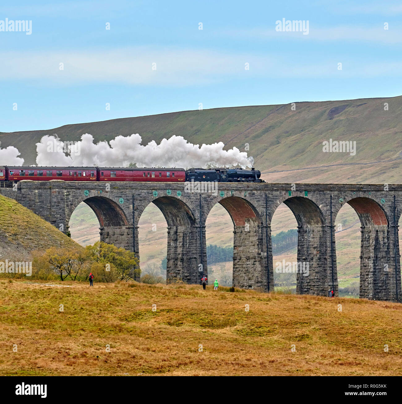 Preserved steam hauled train at Ribblehead Viaduct on the Settle & Carlisle Railway line, Yorkshire Dales National Park, Northern England, UK Stock Photo