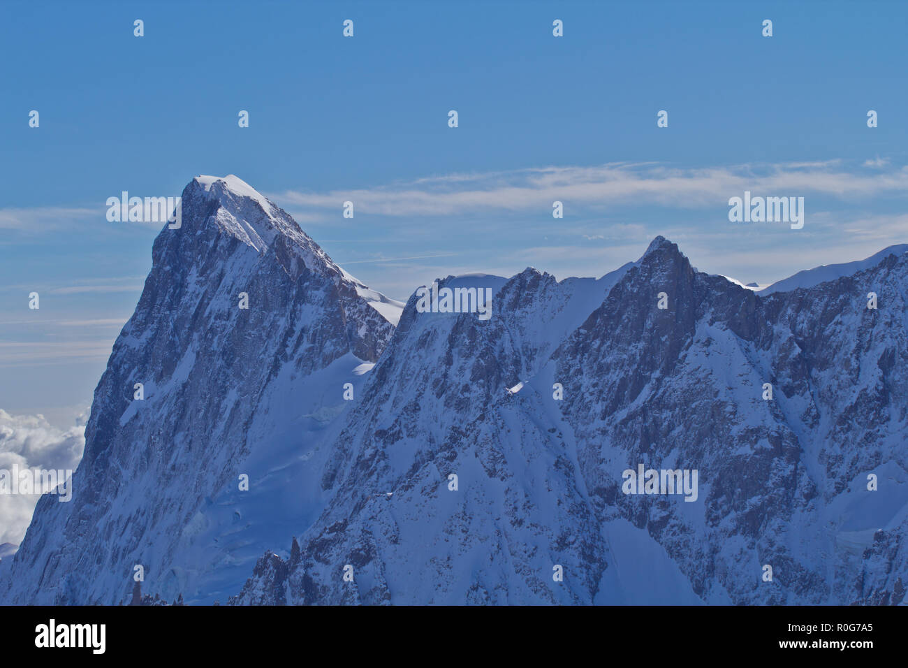 The Aiguille du Midi, The Alps are the highest and most extensive mountain range system that lies entirely in Europe, stretching approximately 1200 km Stock Photo